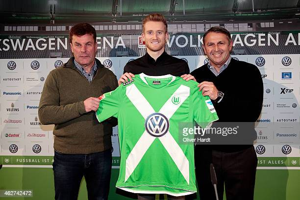 Head coach Dieter Hecking Andre Schuerrle and Manager Klaus Allofs of Wolfsburg poses for the media during the Press Conference at Volkswagen Arena...
