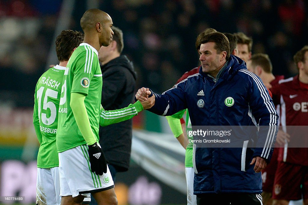 Head coach <a gi-track='captionPersonalityLinkClicked' href=/galleries/search?phrase=Dieter+Hecking&family=editorial&specificpeople=535775 ng-click='$event.stopPropagation()'>Dieter Hecking</a> celebrates with his players after the DFB Cup match between Kickers Offenbach and VfL Wolfsburg on February 26, 2013 in Offenbach, Germany.