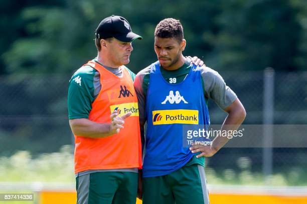 Head coach Dieter Hecking of Borussia Moenchengladbach speak with Kwame Yeboah of Borussia Moenchengladbach during a training session at the Training...