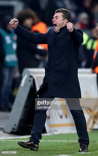 Head coach Dieter Hecking of Moenchengladbach celebrates after winning the Bundesliga match between Bayer 04 Leverkusen and Borussia Moenchengladbach...