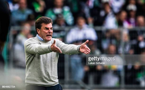 Head Coach Dieter Hecking of Moenchengladbach gestures on the sideline during the Bundesliga match between Borussia Moenchengladbach and Bayer 04...