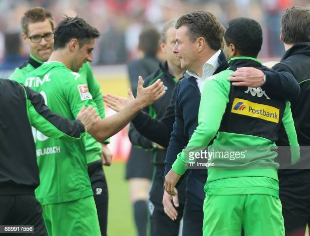 Head coach Dieter Hecking of Moenchengladbach shakes hands with Lars Stindl during the Bundesliga Match between 1FC Koeln and Borussia...