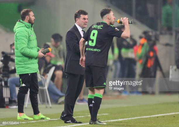 Head coach Dieter Hecking of Moenchengladbach speak with t Josip Drmic during the UEFA Europa League Round of 16 second leg match between Borussia...
