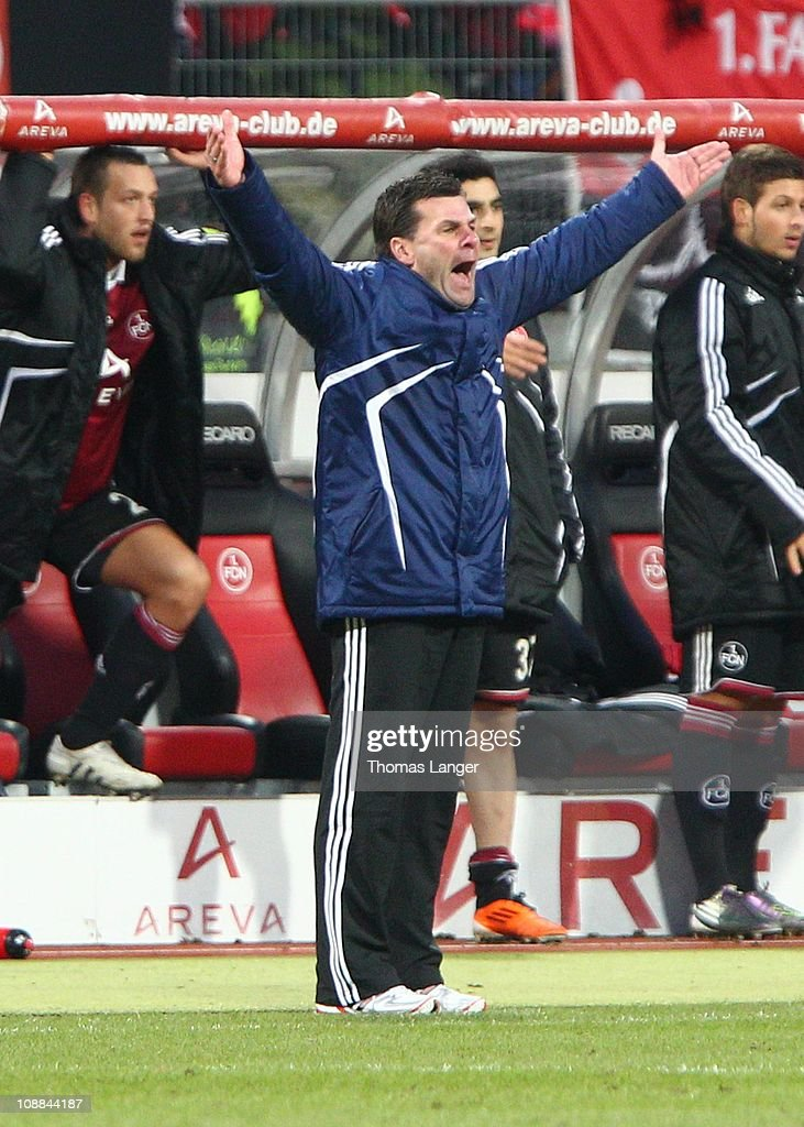 Head coach Dieter Hecking of Nuernberg reacts during the Bundesliga match between 1. FC Nuernberg and Bayer Leverkusen at the Easy Credit Stadium on February 5, 2011 in Nuremberg, Germany.