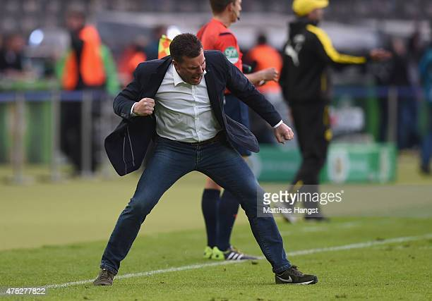 Head coach Dieter Hecking of VfL Wolfsburg celebrates his team's second goal during the DFB Cup Final match between Borussia Dortmund and VfL...