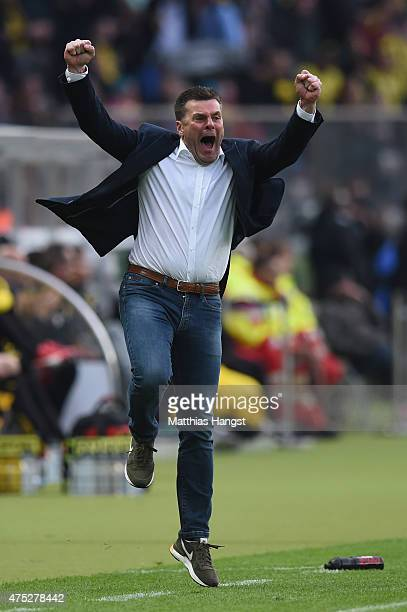 Head coach Dieter Hecking of VfL Wolfsburg celebrates his team's third goal during the DFB Cup Final match between Borussia Dortmund and VfL...