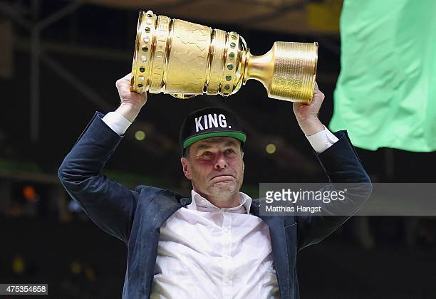 Head coach Dieter Hecking of VfL Wolfsburg celebrates with the trophy after his teams victory in the DFB Cup Final match between Borussia Dortmund...