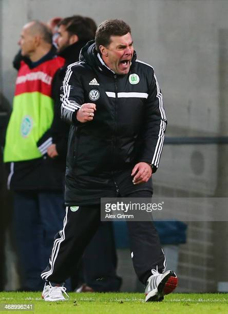 Head coach Dieter Hecking of Wolfsburg celebrates at the final whistle of the DFB Cup quarterfinal match between 1899 Hoffenheim and VfL Wolfsburg at...