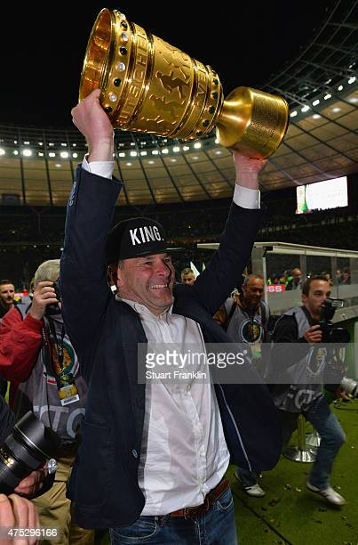 Head coach Dieter Hecking of Wolfsburg celebrates with the trophy following the DFB Cup Final match between Borussia Dortmund and VfL Wolfsburg at...