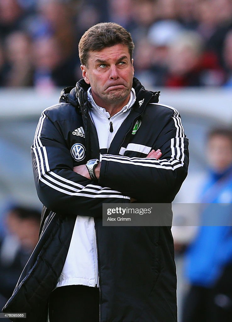 Head coach Dieter Hecking of Wolfsburg reacts during the Bundesliga match between 1899 Hoffenheim and VfL Wolfsburg at Wirsol Rhein-Neckar-Arena on March 2, 2014 in Sinsheim, Germany.