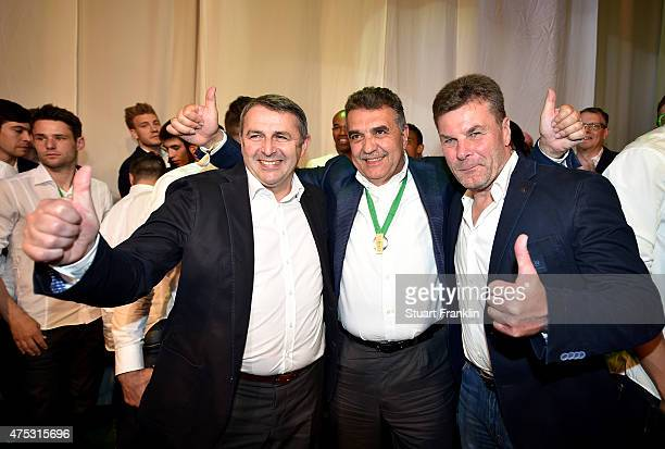 Head coach Dieter Hecking poses with Francisco Javier Garcia Sanz Chairman of Volkswagen Group and Klaus Allofs manager of VfL Volkswagen during the...