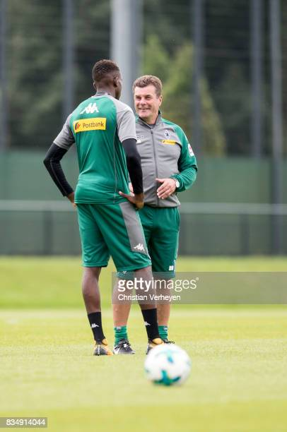 Head Coach Dieter Hecking talks to Denis Zakaria during the training session of Borussia Moenchengladbach at BorussiaPark on August 18 2017 in...
