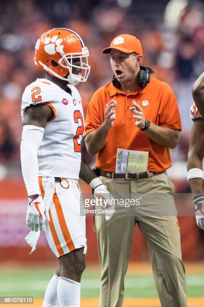 Head coach Dino Babers of the Syracuse Orange speaks with Mark Fields during the fourth quarter against the Syracuse Orange at the Carrier Dome on...