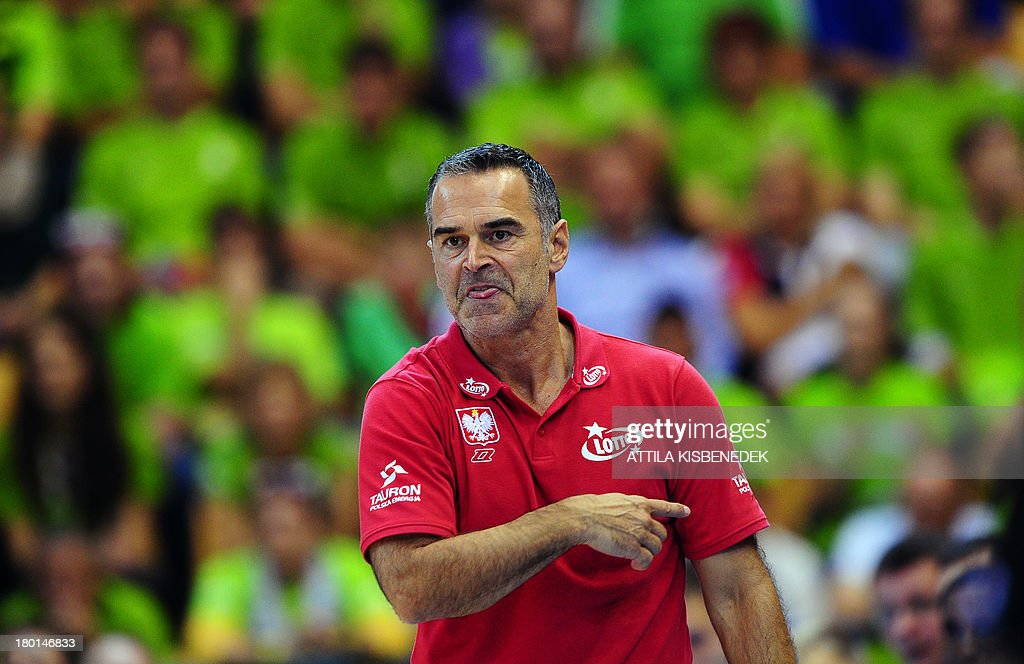 Head coach Dirk Bauermann of Poland briefs his team against Slovenia during the group C qualification match to EuroBasket 2013 Championships between...