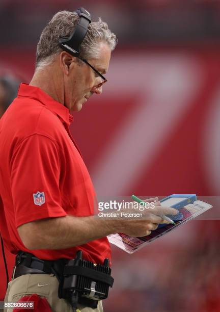 Head coach Dirk Koetter of the Tampa Bay Buccaneers looks at a microsoft surface tablet during the first half of the NFL game against the Arizona...