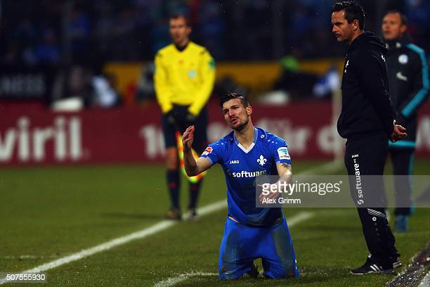 Head coach Dirk Schuster and Jerome Gondorf of Darmstadt react during the Bundesliga match between SV Darmstadt 98 and FC Schalke 04 at MerckStadion...