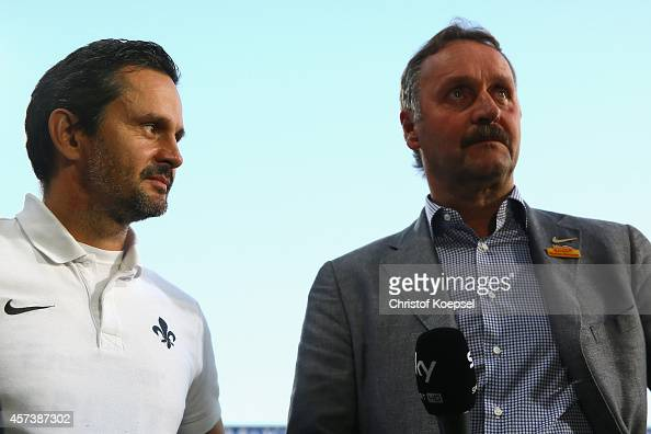 Head coach Dirk Schuster of Darmstadt 98 and head coach Peter Neururer of Bochum are seen prior to the Second Bundesliga match between VfL Bochum and...