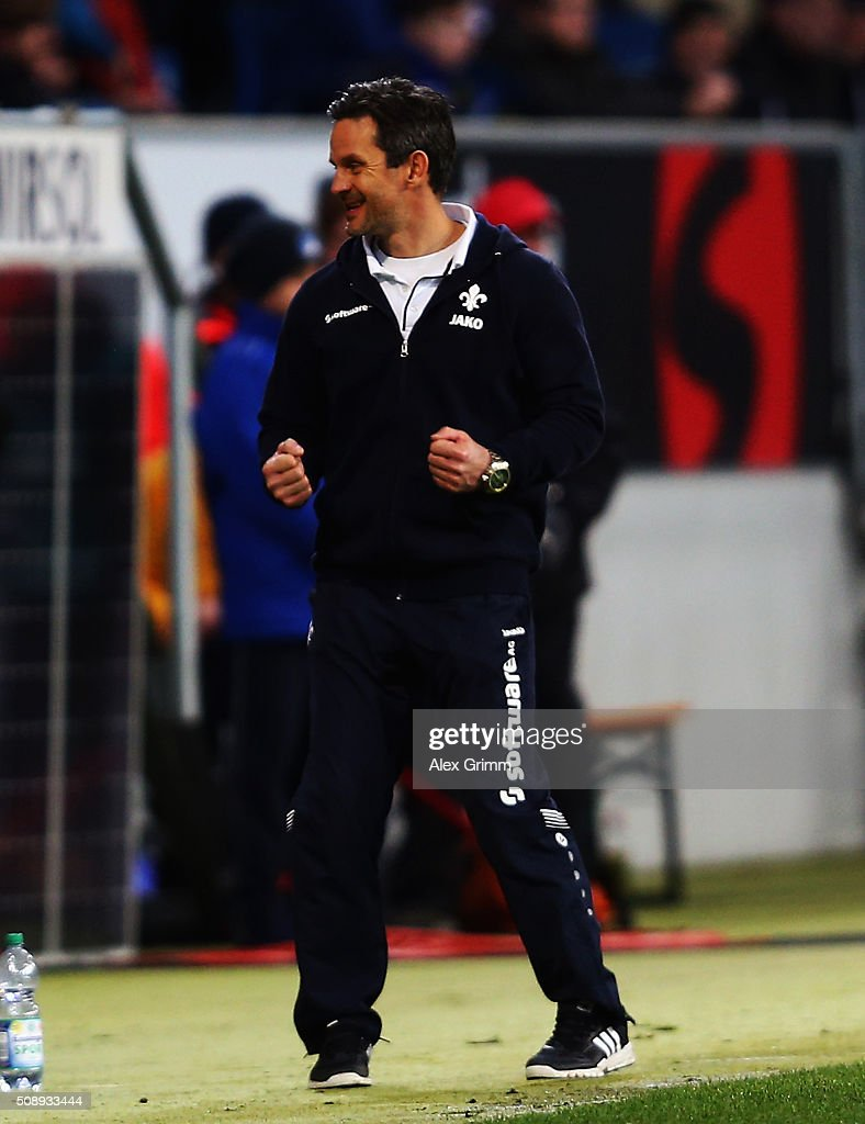 Head coach <a gi-track='captionPersonalityLinkClicked' href=/galleries/search?phrase=Dirk+Schuster&family=editorial&specificpeople=2379789 ng-click='$event.stopPropagation()'>Dirk Schuster</a> of Darmstadt celebrates after the final whistle of the Bundesliga match between 1899 Hoffenheim and SV Darmstadt 98 at Wirsol Rhein-Neckar-Arena on February 7, 2016 in Sinsheim, Germany.