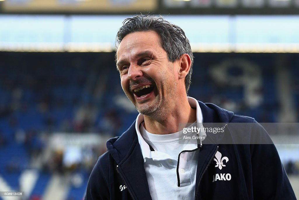 Head coach <a gi-track='captionPersonalityLinkClicked' href=/galleries/search?phrase=Dirk+Schuster&family=editorial&specificpeople=2379789 ng-click='$event.stopPropagation()'>Dirk Schuster</a> of Darmstadt laughs prior to the Bundesliga match between 1899 Hoffenheim and SV Darmstadt 98 at Wirsol Rhein-Neckar-Arena on February 7, 2016 in Sinsheim, Germany.