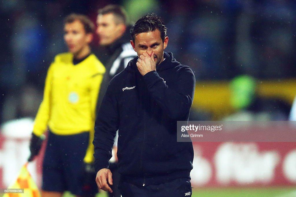 Head coach Dirk Schuster of Darmstadt reacts during the Bundesliga match between SV Darmstadt 98 and FC Schalke 04 at Merck-Stadion am Boellenfalltor on January 30, 2016 in Darmstadt, Germany.