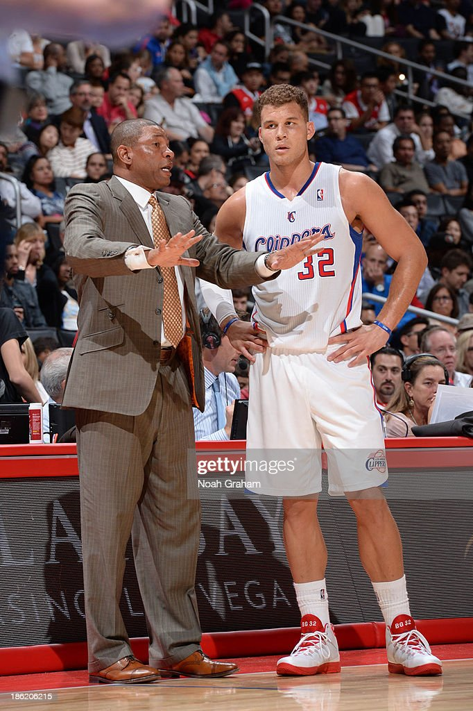 Head Coach <a gi-track='captionPersonalityLinkClicked' href=/galleries/search?phrase=Doc+Rivers&family=editorial&specificpeople=206225 ng-click='$event.stopPropagation()'>Doc Rivers</a> and <a gi-track='captionPersonalityLinkClicked' href=/galleries/search?phrase=Blake+Griffin+-+Basketball+Player&family=editorial&specificpeople=4216010 ng-click='$event.stopPropagation()'>Blake Griffin</a> #32 of the Los Angeles Clippers speak to each other during their game against the Sacramento Kings at Staples Center on October 25, 2013 in Los Angeles, California.