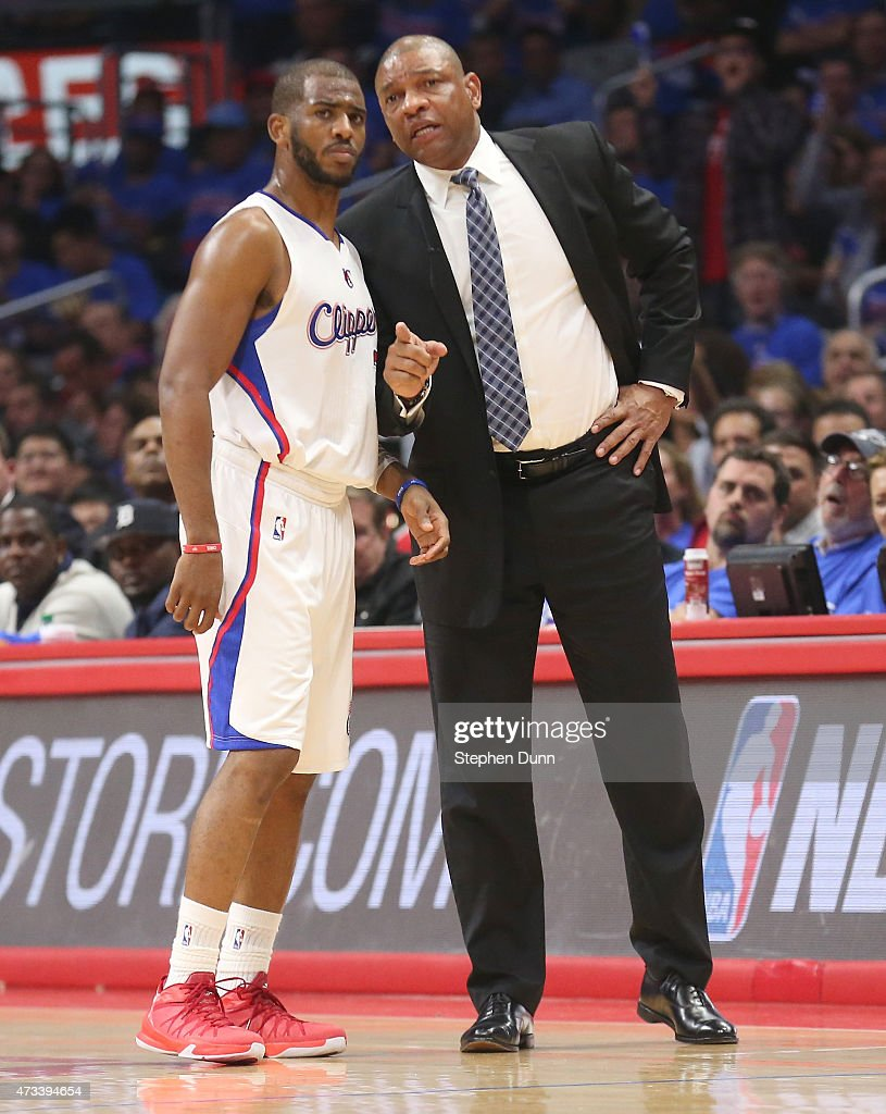 Head coach Doc Rivers and Chris Paul of the Los Angeles Clippers confer against the Houston Rockets during Game Six of the Western Conference...
