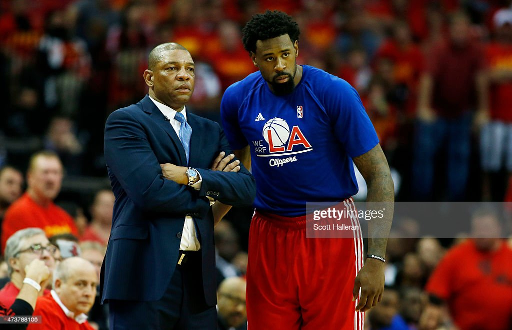 Head coach Doc Rivers and DeAndre Jordan of the Los Angeles Clippers react in the fourth quarter against the Houston Rockets during Game Seven of the...