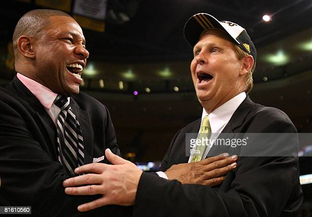 Head coach Doc Rivers and Executive Director of Basketball Operations Danny Ainge of the Boston Celtics celebrate after defeating the Los Angeles...