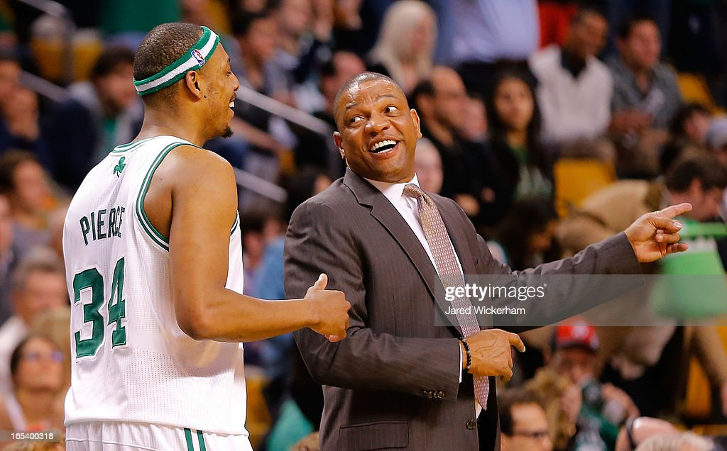 Head coach Doc Rivers and Paul Pierce #34 of the Boston Celtics share a laugh at the end of the fourth quarter against the Detroit Pistons during the game on April 3, 2013 at TD Garden in Boston, Massachusetts.