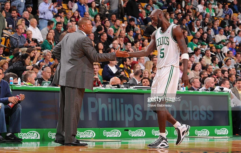 Head Coach Doc Rivers congratulates Kevin Garnett #5 of the Boston Celtics during the game against the Minnesota Timberwolves on December 5, 2012 at the TD Garden in Boston, Massachusetts.