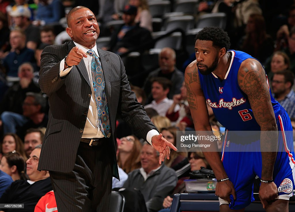 Head coach Doc Rivers leads DeAndre Jordan and the Los Angeles Clippers against the Denver Nuggets at Pepsi Center on December 19 2014 in Denver...
