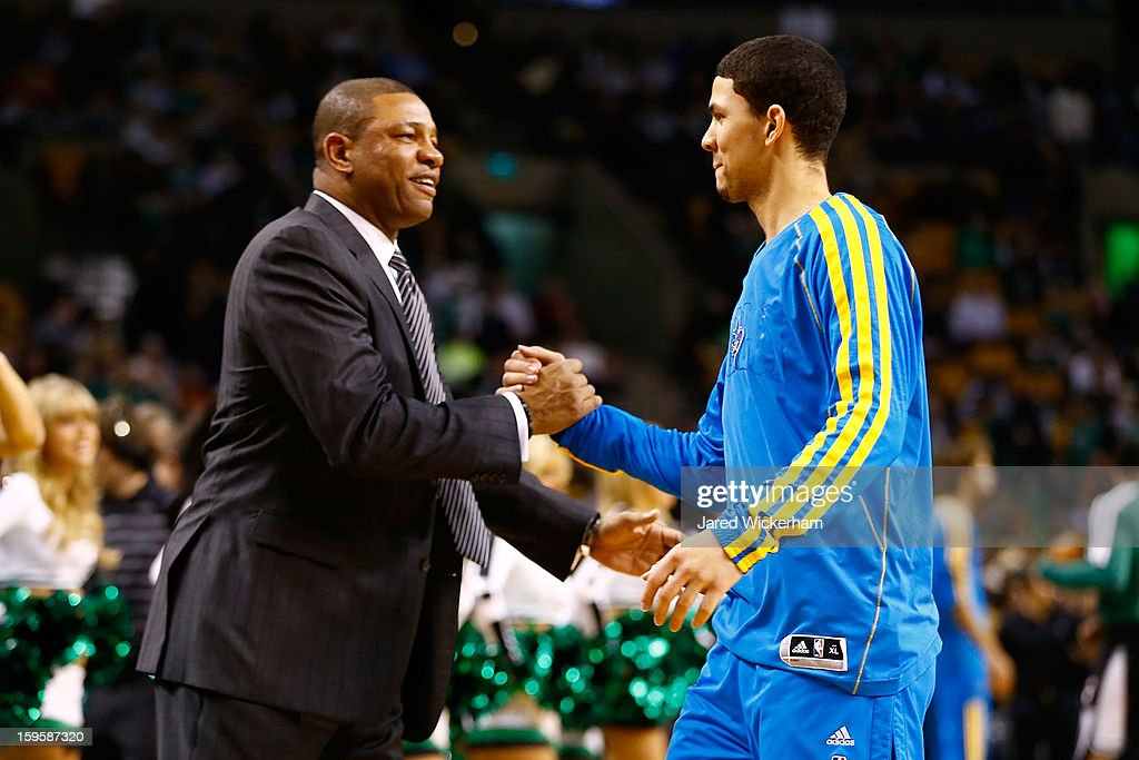 Head coach Doc Rivers of the Boston Celtics and his son Austin Rivers of the New Orleans Hornets greet each other during the game on January 16 2013...