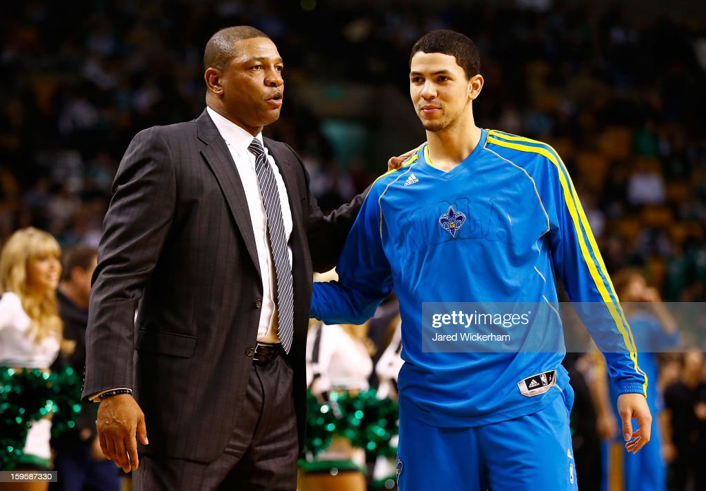 Head coach <a gi-track='captionPersonalityLinkClicked' href=/galleries/search?phrase=Doc+Rivers&family=editorial&specificpeople=206225 ng-click='$event.stopPropagation()'>Doc Rivers</a> of the Boston Celtics and his son, <a gi-track='captionPersonalityLinkClicked' href=/galleries/search?phrase=Austin+Rivers&family=editorial&specificpeople=7117574 ng-click='$event.stopPropagation()'>Austin Rivers</a> #25 of the New Orleans Hornets, greet each other during the game on January 16, 2013 at TD Garden in Boston, Massachusetts.