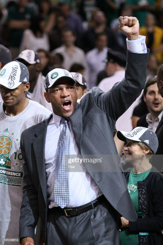 Head coach Doc Rivers of the Boston Celtics celebrates after the Celtics won 9684 against the Orlando Magic in Game Six of the Eastern Conference...