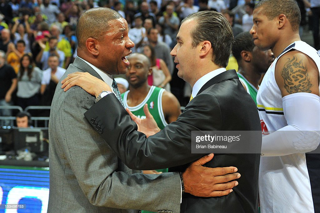 Head Coach <a gi-track='captionPersonalityLinkClicked' href=/galleries/search?phrase=Doc+Rivers&family=editorial&specificpeople=206225 ng-click='$event.stopPropagation()'>Doc Rivers</a> of the Boston Celtics congratulates Head Coach Pianigiani Simone of Fenerbahce Ulker on October 5, 2012 at the Ulker Sports Arena in Istanbul, Turkey.