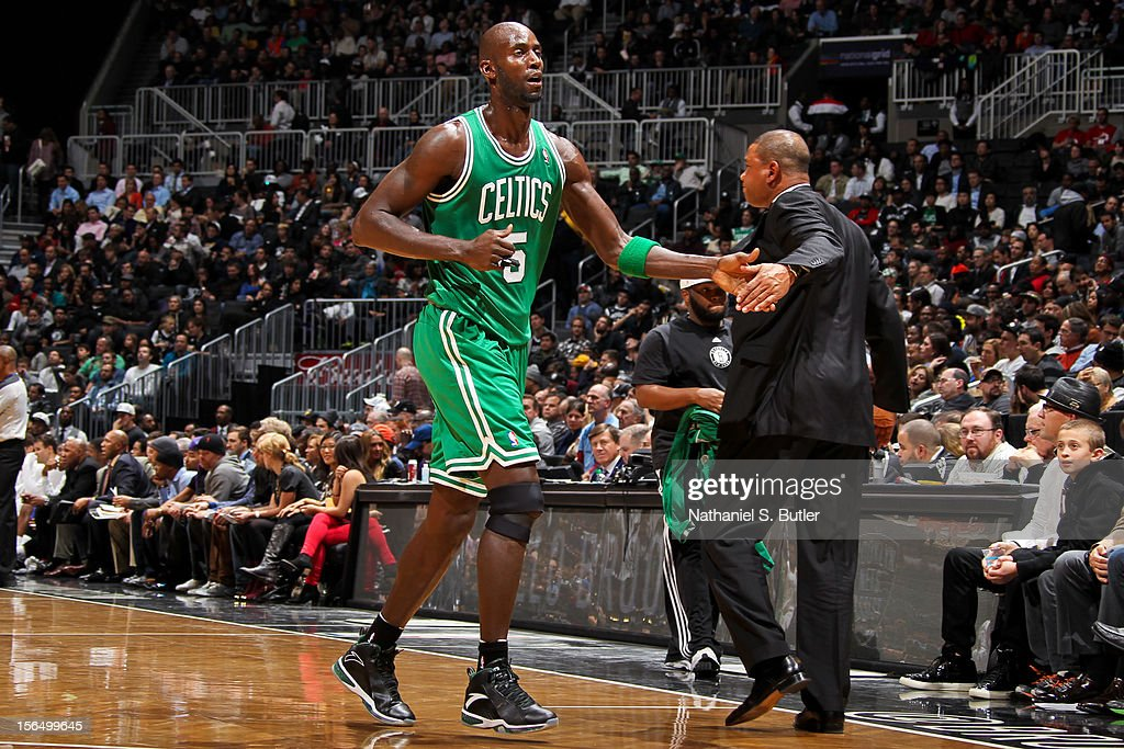 Head Coach Doc Rivers of the Boston Celtics greets Kevin Garnett #5 while playing the Brooklyn Nets on November 15, 2012 at the Barclays Center in the Brooklyn borough of New York City.