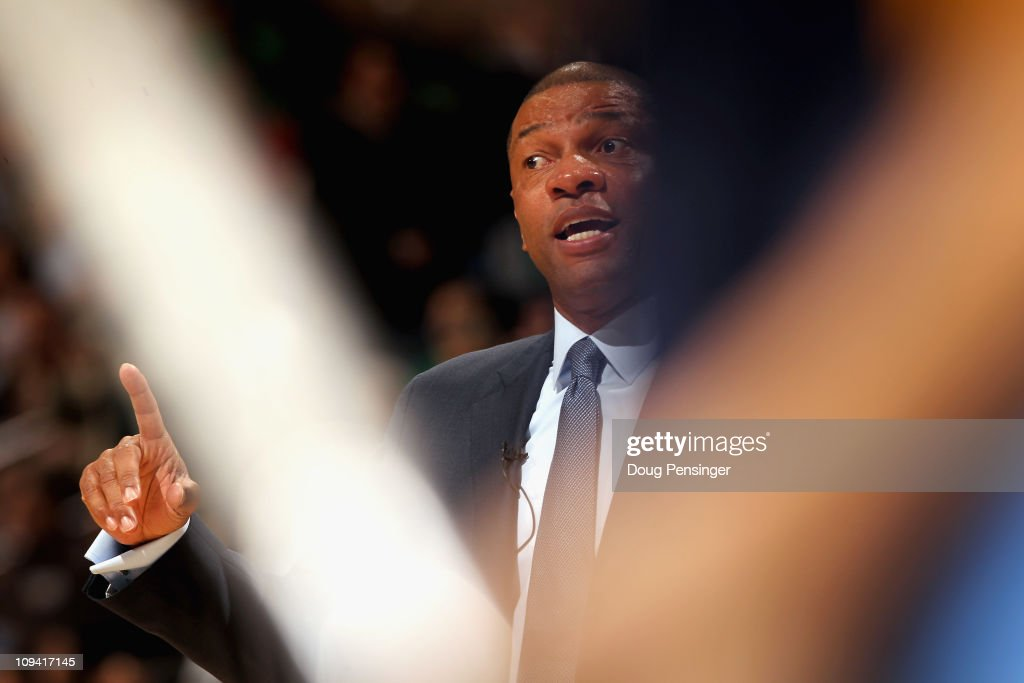 Head coach <a gi-track='captionPersonalityLinkClicked' href=/galleries/search?phrase=Doc+Rivers&family=editorial&specificpeople=206225 ng-click='$event.stopPropagation()'>Doc Rivers</a> of the Boston Celtics leads his team against the Denver Nuggets during NBA action at the Pepsi Center on February 24, 2011 in Denver, Colorado. The Nuggets defeated the Celtics 89-75.