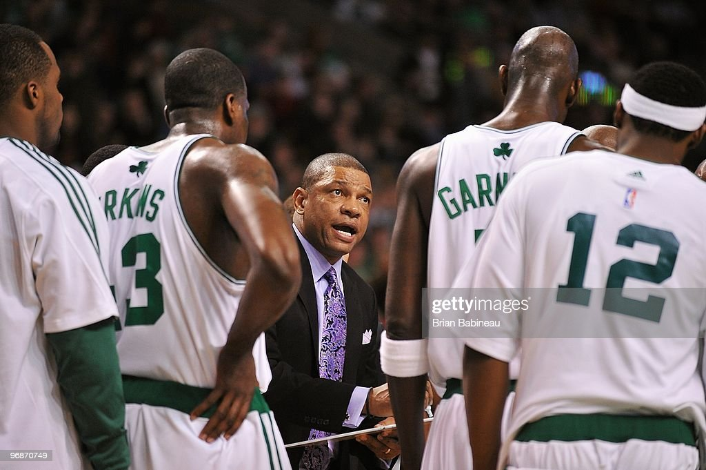 Head coach Doc Rivers of the Boston Celtics talks to his team during a timeout in the game against the Portland Trail Blazers on January 22 2010 at...