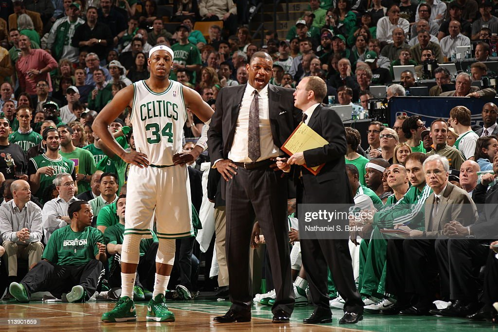Head coach Doc Rivers of the Boston Celtics talks with assistant head coach Lawrence Frank during a break in the action against the Miami Heat during...