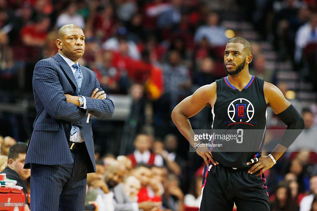 Head coach Doc Rivers of the Los Angeles Clippers and Chris Paul #3 wait near the bench during their game against the Houston Rockets at Toyota Center on December 19, 2015 in Houston, Texas.