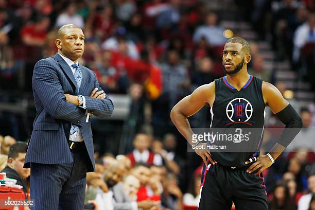 Head coach Doc Rivers of the Los Angeles Clippers and Chris Paul wait near the bench during their game against the Houston Rockets at Toyota Center...
