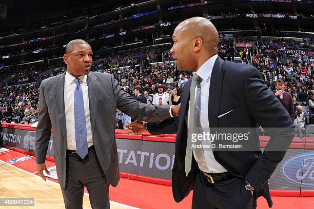 Head coach Doc Rivers of the Los Angeles Clippers and head coach Derek Fisher of the New York Knicks greet each other before the game on December 31...