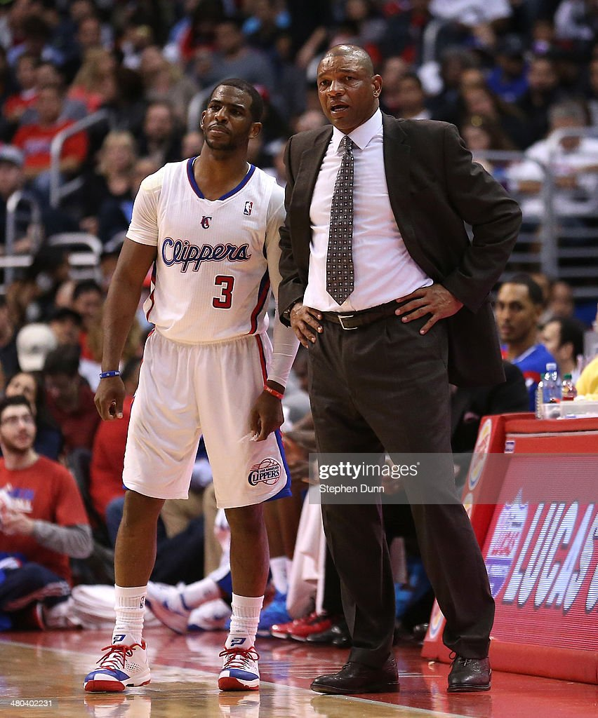 Head coach <a gi-track='captionPersonalityLinkClicked' href=/galleries/search?phrase=Doc+Rivers&family=editorial&specificpeople=206225 ng-click='$event.stopPropagation()'>Doc Rivers</a> of the Los Angeles Clippers confers with <a gi-track='captionPersonalityLinkClicked' href=/galleries/search?phrase=Chris+Paul&family=editorial&specificpeople=212762 ng-click='$event.stopPropagation()'>Chris Paul</a> #3 during the game with the Milwaukee Bucks at Staples Center on March 24, 2014 in Los Angeles, California. The Clippers won 106-98.