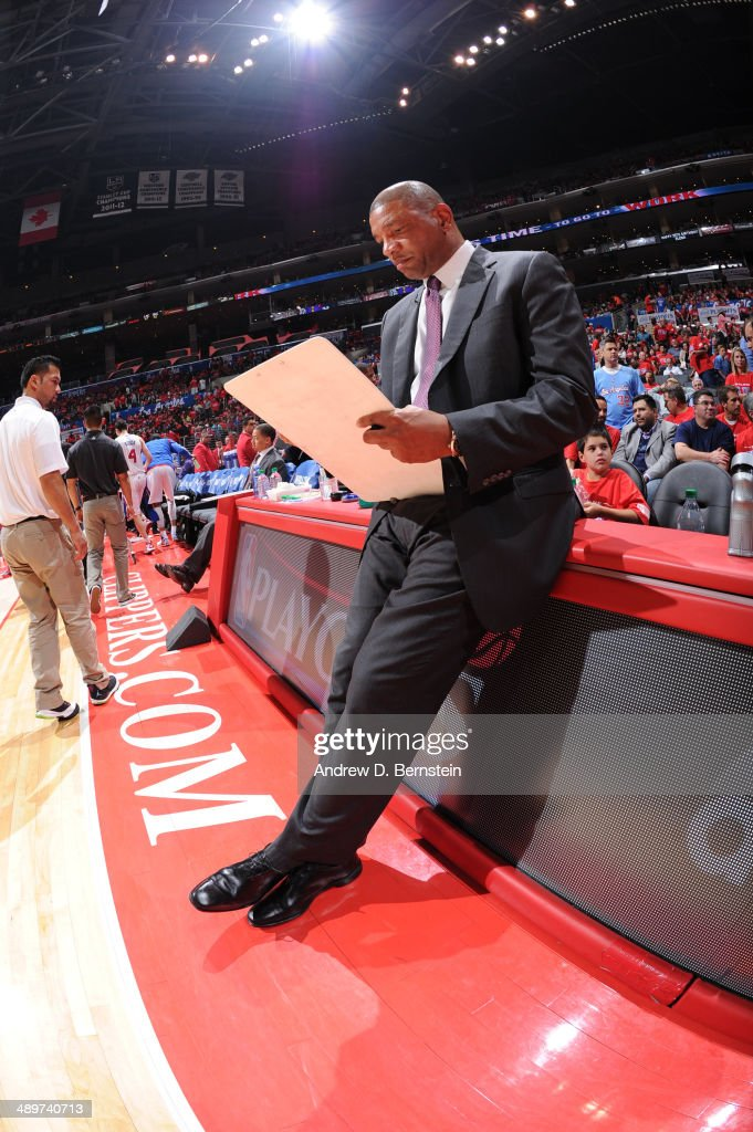 Head coach <a gi-track='captionPersonalityLinkClicked' href=/galleries/search?phrase=Doc+Rivers&family=editorial&specificpeople=206225 ng-click='$event.stopPropagation()'>Doc Rivers</a> of the Los Angeles Clippers draws up a play in Game Three of the Western Conference Semifinals during the 2014 NBA Playoffs at Staples Center on May 9, 2014 in Los Angeles, California.