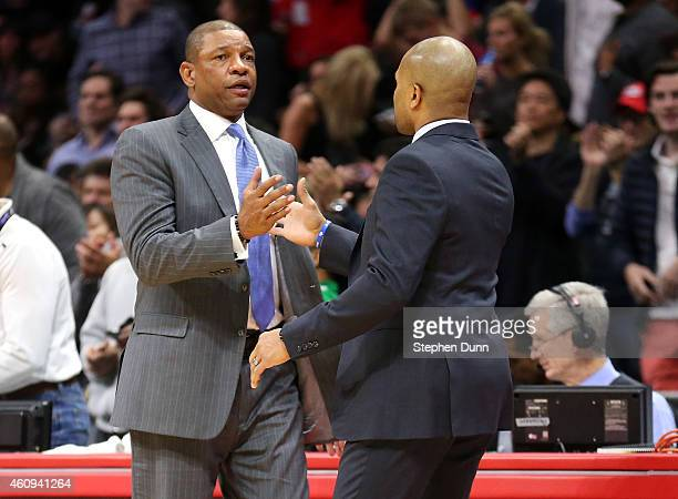 Head coach Doc Rivers of the Los Angeles Clippers greets head coach Derek Fisher of the New York Knicks after the game at Staples Center on December...