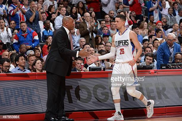 Head Coach Doc Rivers of the Los Angeles Clippers high fives Austin Rivers of the Los Angeles Clippers during the game against the Golden State...