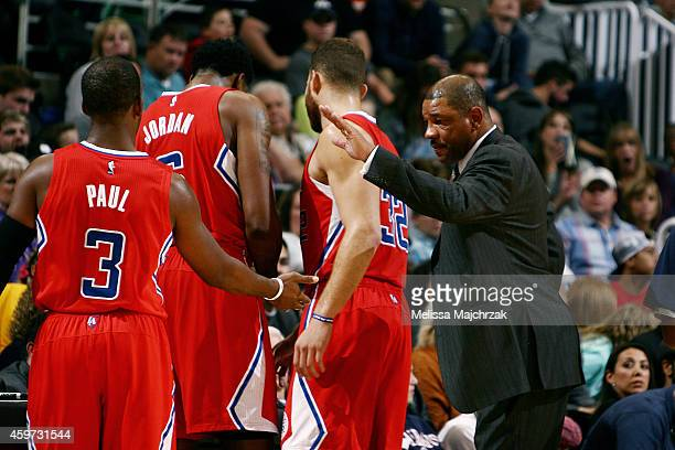 Head coach Doc Rivers of the Los Angeles Clippers high fives Chris Paul in a game against the Utah Jazz at EnergySolutions Arena on November 29 2014...