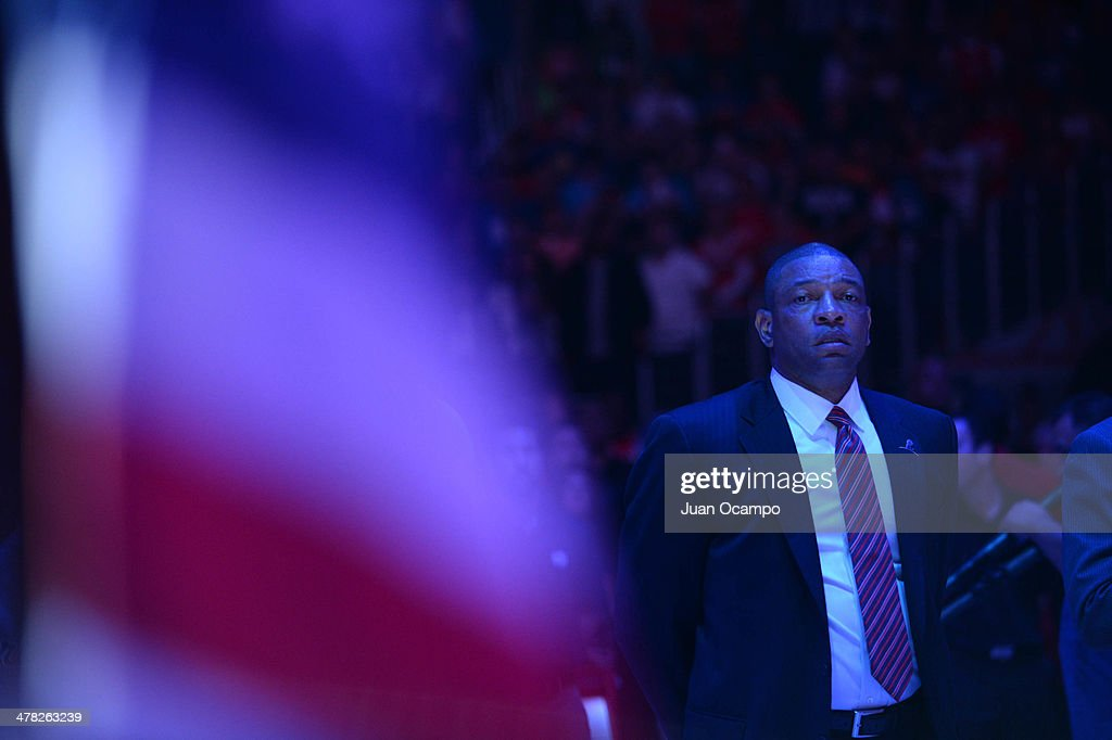 Head coach Doc Rivers of the Los Angeles Clippers looks on during the performance of the National Anthem before facing the Golden State Warriors at Staples Center on March 12, 2014 in Los Angeles, California.