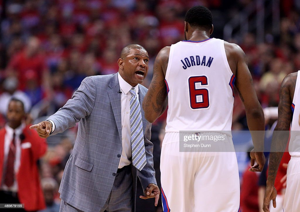 Head coach Doc Rivers of the Los Angeles Clippers talks to DeAndre Jordan during the game against the Golden State Warriors in Game One of the...