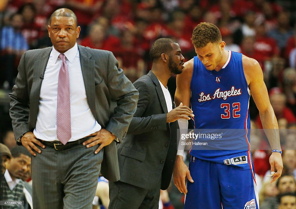 Head coach <a gi-track='captionPersonalityLinkClicked' href=/galleries/search?phrase=Doc+Rivers&family=editorial&specificpeople=206225 ng-click='$event.stopPropagation()'>Doc Rivers</a> of the Los Angeles Clippers waits alongside <a gi-track='captionPersonalityLinkClicked' href=/galleries/search?phrase=Chris+Paul&family=editorial&specificpeople=212762 ng-click='$event.stopPropagation()'>Chris Paul</a> #3 and <a gi-track='captionPersonalityLinkClicked' href=/galleries/search?phrase=Blake+Griffin+-+Basketballer&family=editorial&specificpeople=4216010 ng-click='$event.stopPropagation()'>Blake Griffin</a> #32 on the court in the second half against the Houston Rockets during Game Two in the Western Conference Semifinals of the 2015 NBA Playoffs on May 6, 2015 at the Toyota Center in Houston, Texas.